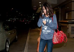Selena Gomez arriving at LAX airport on March 2, 2012