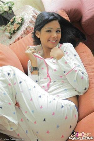 Karla Spice takes off her white pyjamas
